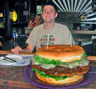 Brad Sciullo of Uniontown, Pa., is seen before attempting to eat a 15-pound cheese burger with five pounds of toppings including bun, lettuce, tomatoes, cheese, onions, mild banana peppers and a cup each of ketchup, mustard, relish, and mayonnaise at Denny's Beer Barrel Pub in Clearfield, Pa., on Monday. (AP Photo/Logan Cramer, Denny's Beer Barrel Pub)
